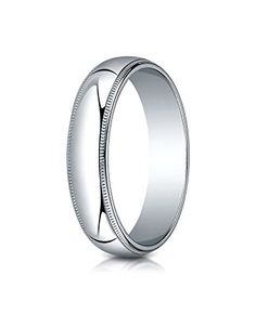 This remarkable Platinum 5mm band features a slightly domed surface with milgrain edges and is flat on the inside for a traditional profile.  Made in the United States. Ships within 2-3 business days....