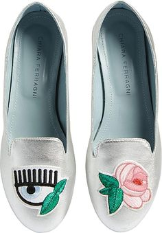 CHIARA FERRAGNI Women's Shoes in Silver Color. Signature rose and batting-eye appliques grace a metallic leather flat with a loafer profile and a collapsible heel counter that lets you style it like a mule.