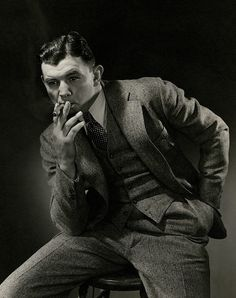 Publication: Vanity FairImage Type: PhotographDate: June Portrait of American boxer James J. Braddock with a cigar in his mouth. Art Poses, Portrait Poses, Portraits, Male Pose Reference, Drawing Reference, Man Smoking, Cigar Smoking, Anatomy Poses, Sitting Poses