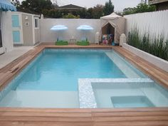 Pool and Spa Design Today: Wood Decks Instead of Masonry materials