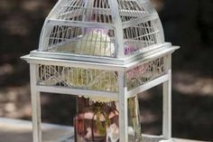 Bird Cages help to bring together this Shabby Chic themed garden wedding.