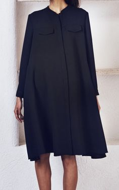 Long sleeve snap front dress with a full sweep in our classic double georgette fabric. Covered front placket. Flap pockets at the front chest. Single button cuffs on the sleeves. Raw edge on the hem. Relaxed fit. #rachelcomey