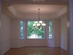 floor to ceiling bay windows in dining room | Dining room w/ bay window and step ceiling