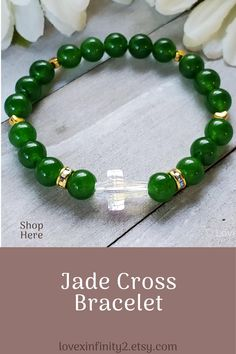 This Green Jade Gemstone Cross bracelet is made with 8mm Chinese green jade beads, tiny gold heart spacers, and features a brilliant Swarovski Crystal Cross accent bead. Feng Shui Jade is known for harmony, balance, protection and for good luck. It is said to bless whatever it touches bringing love, wealth, prosperity, and abundance.