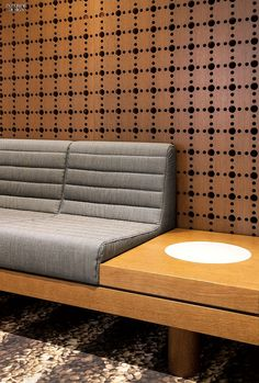 A Taste of Japan Hotel Ambassador Spa by Ali Tayar A wall of perforated stained oak rises behind an oak banquette with wool upholstery Living Room Upholstery, Upholstery Trim, Furniture Upholstery, Furniture Design, Upholstery Cleaner, Furniture Nyc, Booth Seating, Banquette Seating, Deco Restaurant