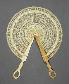 circa 1790 — circa 1820. Cockade brise fan of ivory with one, small, central mongram cartouche.