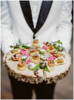 13. MIX UP YOUR SERVING PLATES Something that is more likely to get overlooked when planning your wedding is what are your beautiful food and drinks going to be served on? A bit outside the box, but mixing up your serving trays with something more in line with your theme, is an exciting way to make your wedding reception unique! We love wooden serving trays- very 'in' right now and far more exciting than the traditional black or silver serving trays.