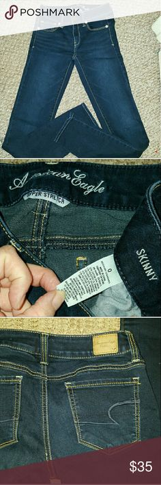 SKINNY SUPER STRETCH American Eagle Jeans NWOT New without tags ~ Size 0 Skinny Jeans by American Eagle. 65% cotton 23% rayon 1% polyester 1% spandex.  Dark wash and great for dress up or casual. American Eagle Outfitters Jeans Skinny