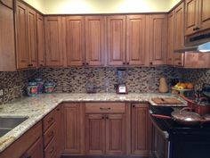 "THIS! But in a white kitchen w/ soapstone counters.   golden road blend BRICKS 1/2"" x 2"" glass tile - shop glass tiles at glasstilestore.com"