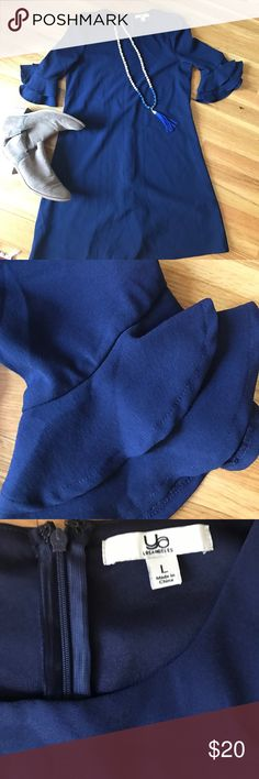 Ya navy blue dress or long top Ya Los Angeles navy blue dress or long top to wear with jeggings. Ruffled sleeves. Worn twice! Ya Los Angeles Dresses