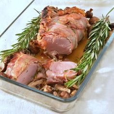Pork Tenderloin wrapped in Pancetta. Ovenbaked with thyme, rosemary and mushrooms.