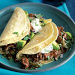 Cola Shredded Beef Tacos Recipe | MyRecipes.com - features shredded beef chuck roast flavored with cola, tomatoes, chiles,  and cumin.