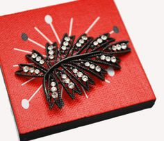 This beautiful Weiss  brooch consists of  clear rhinestones in a black leaf flower design. These rhi