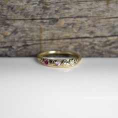 Small 14k gold Volmer ring with two 2mm pink sapphires and one 2mm diamond in natural settings and with a 3-3.5mm band-width.All Kria jewelry is handmade in our Catskills studio and store using... Pink Sapphire, Precious Metals, Gems, Band, Studio, Stone, Diamond, Natural, Rings