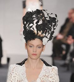 Paper hat from the Chanel Couture show. Designed by Katsuyo Kamo who also did the hair and other flower ornaments.