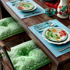 Pioneer Woman Linens. Love the green! They would also work great as outdoor chair cushions.