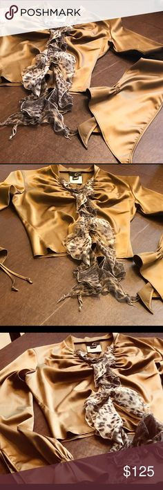 """Just Cavalli Blouse """"Vintage"""" Stunning Authentic Just Cavalli bronze colored blouse, with gorgeous flared sleeves that tie at the bottom. A divine neckline, buttons with a ruffled flowing, animal sash. This unique piece is NWOT, I removed the tags and decided I didn't care for the fit.                                                                         ▪️94% Polyester 6% Spandex Just Cavalli Tops Blouses"""