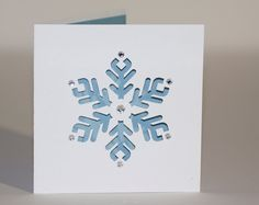 snowflake card...luv the look of light blue and white for snowflakes...negative snowflake die space backed in blue...a little sparkle too...