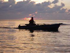 Twilight and Fisherman, Disa Beach, Sahu, North Maluku. Indonesia