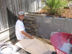 maybe try to match the rock on the house to cover the retaining wall in the backyard covering cement blocks with rock facing. The best way to dress up that oh so important retaining wall! Backyard Projects, Outdoor Projects, Backyard Patio, Garden Projects, Backyard Landscaping, Landscaping Ideas, Backyard Ideas, Stone Backyard, Landscaping Blocks