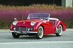 1959 Triumph TR3A  My older brother had one of these for years.  Started out red and was repainted a dark, deep brown.