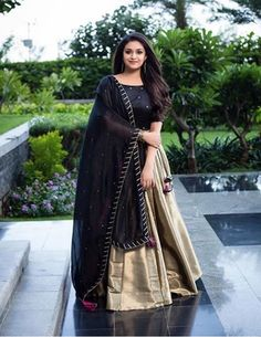 Indian actress Keerthy Suresh wears a stunning black and gold lehenga for the promotions of her upcoming tamil movie Sandaikozhi 2 . Indian Gowns Dresses, Indian Fashion Dresses, Dress Indian Style, Indian Designer Outfits, Indian Outfits, Designer Dresses, Designer Lehanga, Shadi Dresses, Indian Attire