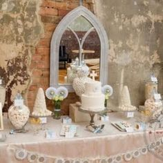 """love the mix of textures and the use of a """"church window"""" mirror to set the stage!"""
