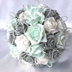 Click here to get eBay seller tools at Auctiva comBRIDES POSY BOUQUET IN MINT GREEN GREY AND WHITE ROSESThis beautiful posy has been made with a