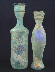 "I can't find a source for this image, allegedly of Roman glass bottles - strange that there are grooves near the tops of the necks (that doesn't look like other ""early Roman"" I've seen at all...), combined with flat bottoms- and one of them looks like a coca cola bottle!  If anyone has a verifiable source, please do kindly let me know!"