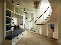 Create entryway mudroom combo in front of some nice stairs.