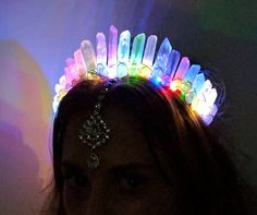 Light up the night. This crown is made to order, crystals may vary in size and shape. LED lights have about a 20 hour battery life. Replaceable batteries available, search for model number B0136BFTWI. I am handcrafted with raw white angel aura crystal quartz. I can be worn as a