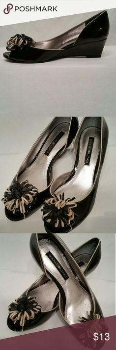 BANDOLINO Black Wedge Shoes Black wedge shoes, patent leather like shine. Ribbon tassel on the toes. Great condition. Size 5 medium. Bandolino Shoes Wedges