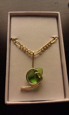 Zelda inspired Kokiri Spiritual Stone charm necklace. $10.00, via Etsy.