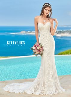 Amazing mermaid gown from Kitty Chen Couture. Strapless, sweetheart neckline, beaded applique lace and chapel-length train.