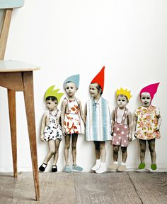 http://nonesuchthings.com. Cardboard People - 5 kids  Measures 21cm x 19cm. A lovely vintage image of 5 kids that has been added to with colourful hats, and garments by French designer Zoe de las Cases. The kids pop out of the cardboard housing and can be stuck on a wall, or popped on a shelf to add a really lovely accent to a bedroom/room.