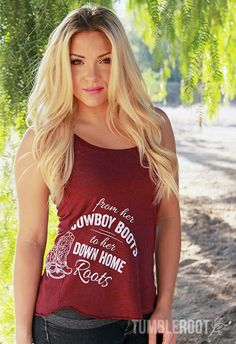The perfect tank top for all you country ladies! This original, country typographic design is screen printed with quality inks onto comfortable, women's tri-blend, racerback tanks. Fully machine washa