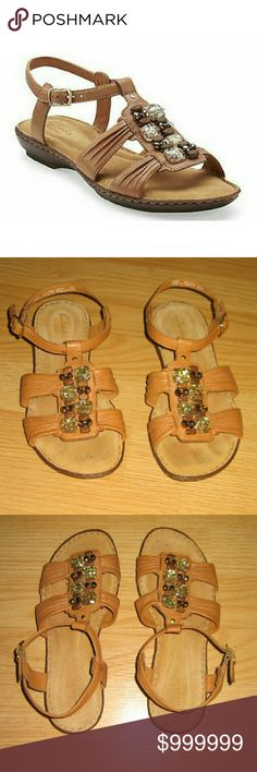 Clarks Artisan Brisk Rosebud Tan Leather Sandals These sandals look to be preloved but in very good to excellent condition. Looks hardly worn if at all. They are the Brisk Rosebud in Tan Leather. Style #60854. All the beading is still attached. Leather upper Balance man made. Size is 6M. Clarks Shoes Sandals