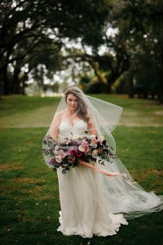 Moody Bouquet | plum wedding flowers | mauve bouquet | Oversized bouquet | greenery runner | smilax | greenery and candles | circle arbor | moon gate | flower arch | flower circle arbor | Moody-Hued Intimate Wedding at Legare Waring House