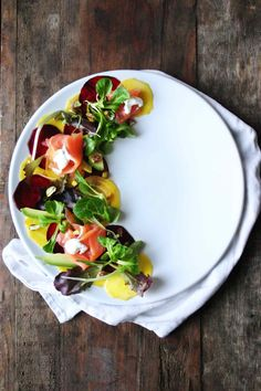 Gorgeous fresh raw beetroot salad with smoked salmon, horseradish cream and pistachios