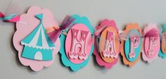 Pink Turquoise and Orange Vintage Circus Tent Happy Birthday Banner Shabby Chic Carnival Party Baby Shower Decorations. $40.00, via Etsy.