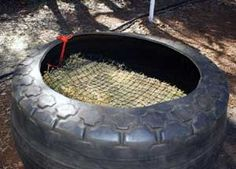 "Natural Horse World Home - slow feed hay feeder for horses made using a ""rag wall"" tire"