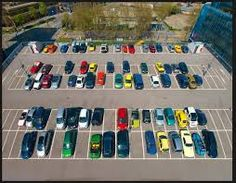 Cars parked in different ordered with different colours