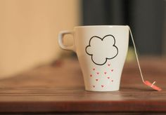 """This adorable mug features a fluffy little cloud raining down drops of love. Created by Squack Doodle in North Carolina"""