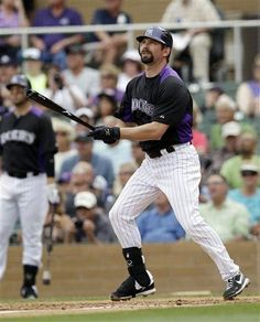 Todd Helton watches a Spring Training homer.