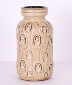 A fine example of collectable vintage West German pottery – this Scheurich ceramic vase has a cream glaze over a brown base and measures 22cms high. We have a smaller version of the same vase and they look great together so why not buy both?