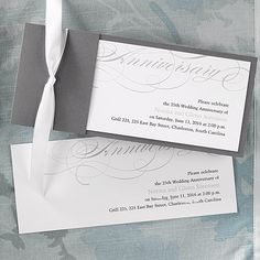 This bright white card has anniversary spelled out at the top and includes a silver wrap and pre- cut ribbon.