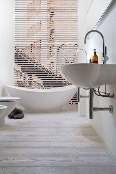 These look like our porcelain tiles that look like wood that we are putting in the bathroom!  modern beach house style by the style files