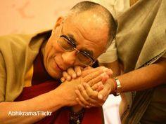 Dalai Lama holding hand