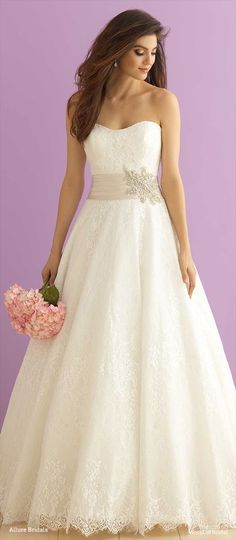 The focal point of this lace gown is the gorgeous Swarovski crystal beading  and ruched satin a804bb7cdd8c