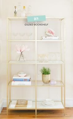 DIY. Ikea hack: gold and marble bookshelf I LOVE the addition of the marble!